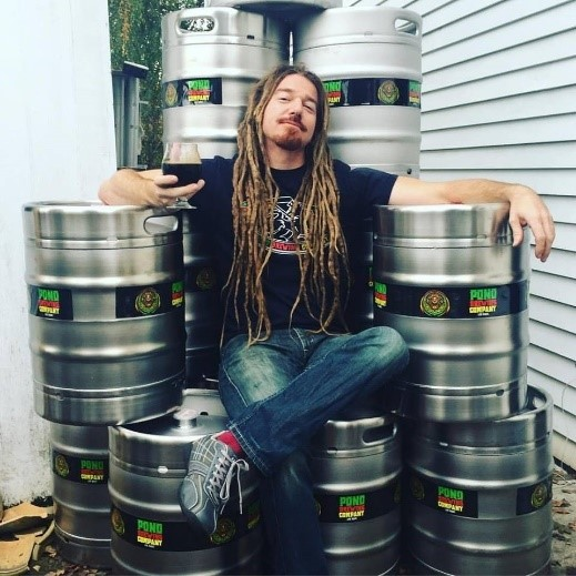Erick Russ with Kegs