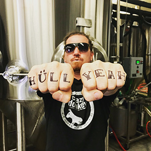Founder Erick Russ with fists to the camera and the words Hull Yeah on his fingers